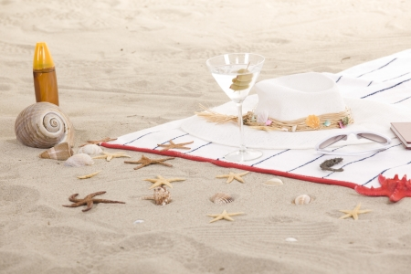weekend break: beach items on sand for fun summer holiday