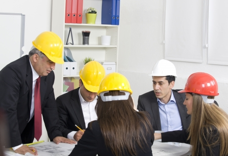 construction company: Architects working in office on construction project Stock Photo