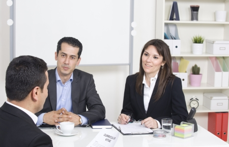 man explaining about her profile to business managers at a job interview Фото со стока