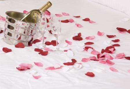 wine in bed to celebrate Valentine's Day at hotel room Standard-Bild