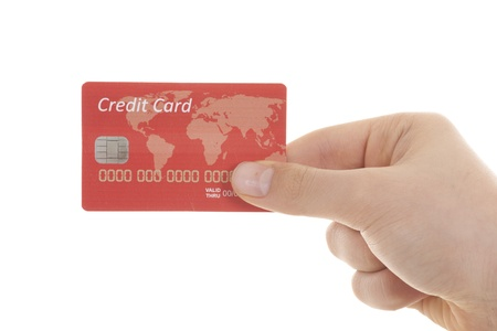 hand with credit card over white background