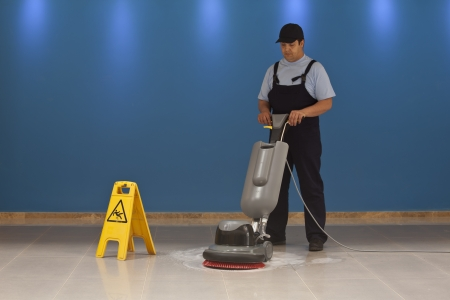man machine: cleaning floor with machine Stock Photo