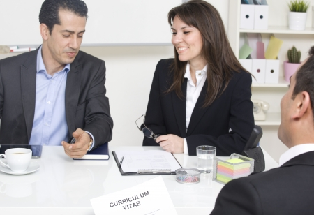 applicant: man explaining about her profile to business managers at a job interview Stock Photo