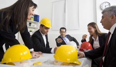 architects sitting at table and looking at a project Stock Photo - 21144798