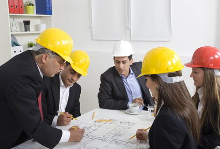 Architects working in office on construction project Stock Photo - 21144799