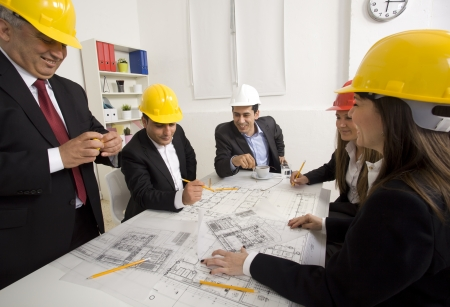 Architects working in office on construction project Stock Photo - 21144800