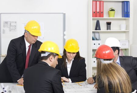 security company: Architects working in office on construction project Stock Photo