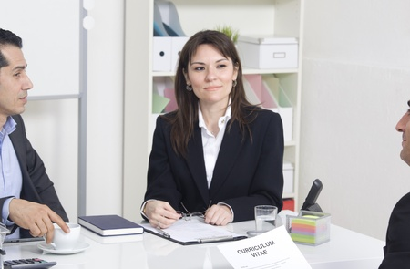 man explaining about her profile to business managers at a job interview Stock Photo - 21144804