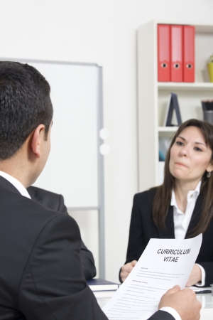 man explaining about her profile to business managers at a job interview photo