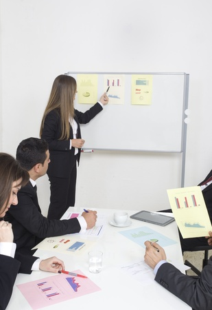 Woman making a business presentation to a group Stock Photo - 21144808