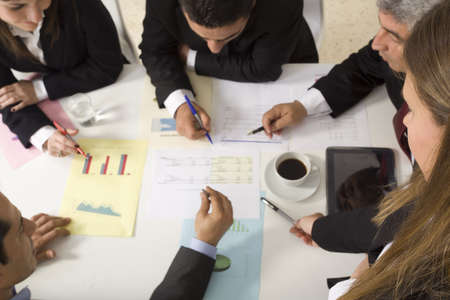 Businesspeople working together at meeting, discussing document Stock Photo - 21144812
