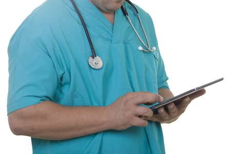 Doctor working on a digital tablet Stock Photo - 21144815