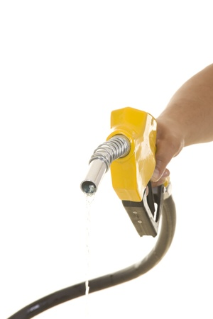biodiesel: Male hand wasting gas with yellow pump isolated on white