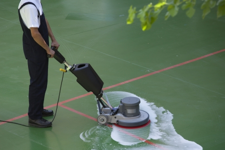 commercial: cleaning floor with machine Stock Photo