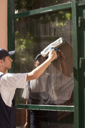building worker: window cleaning Stock Photo