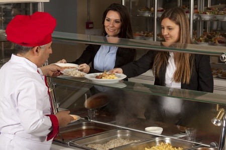 canteen: chef standing behind full lunch service station