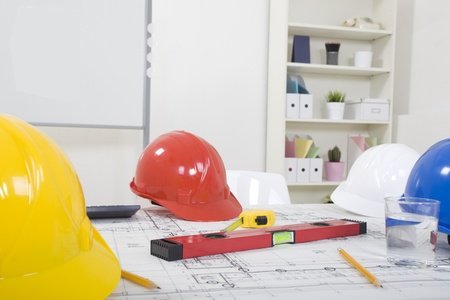 measuring instruments: Hardhat  and measuring instruments on blueprint Stock Photo