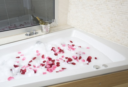 bath: A relaxing bath with rose petals ,wine and glassess