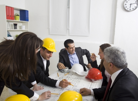 architects sitting at table and looking at a project photo