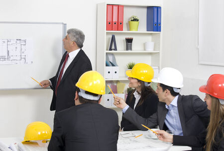 safety hat: architect giving presentation to a small business group