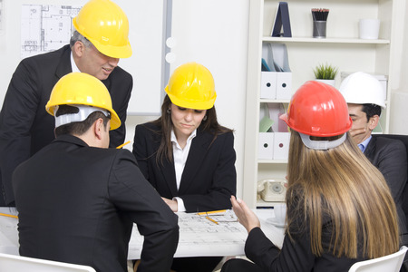 Architects working in office on construction project photo