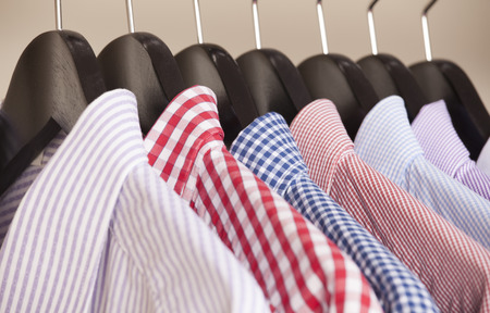hangers: variety of shirts on hangers Stock Photo