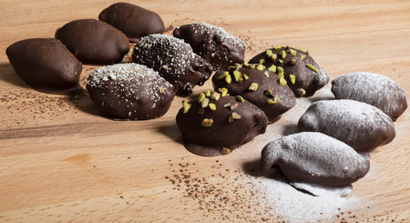 homemade natural chocolate truffle on wooden background