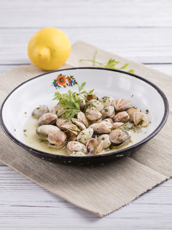clams in very old plate with green parsley