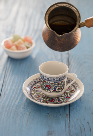 turkish coffee and turkish delights on wooden back ground Stock Photo