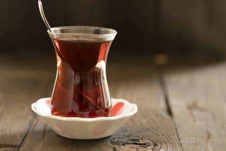 turkish tea with authentic glass cup on dark back ground