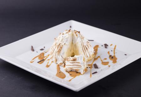 baked alaska desert on white plate Reklamní fotografie