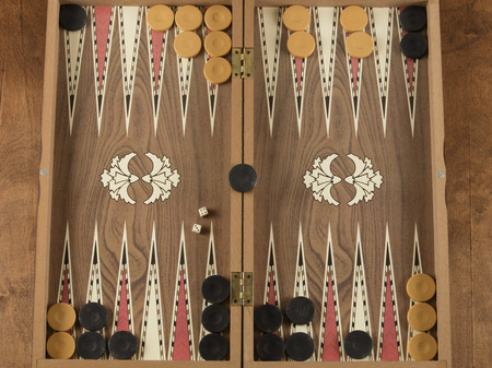 detail of a backgammon game with two dice close up Stock Photo