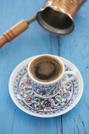 turkish coffee served in a traditional cup on wooden back ground Stock Photo