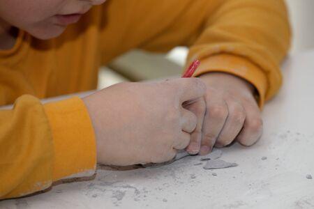 children's entertainment, a child plays in an archaeologist, children's hands dig dinosaur bones