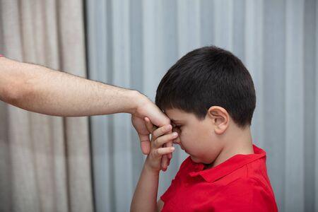 Little boy kiss his father's hand during Eid mubarak (Turkish Ramazan or Seker Bayram). Adorable child kiss elderly man hand to show respect. Cute toddler follow muslim Ramadan traditions