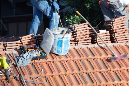repairing the roof of a home