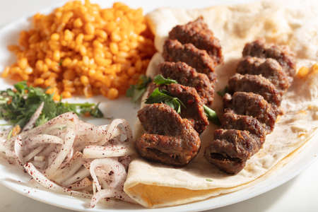 Turkish Adana Kebab with Vegetables on the Plate Stock Photo