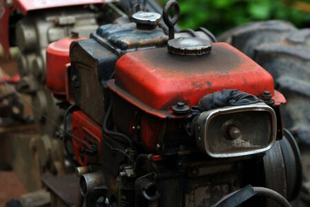 gasoline powered: old tractor for work at farmer