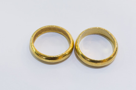gold rings: Two gold  rings on a white background.