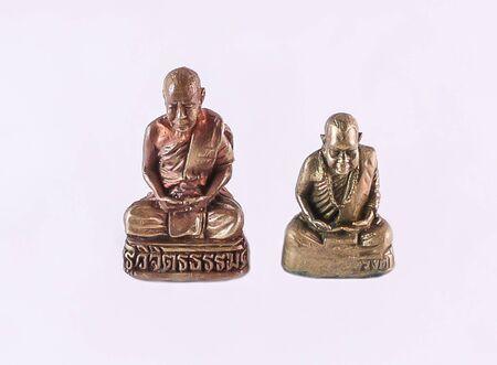 buddha image: Small Buddha image amulet on white background.