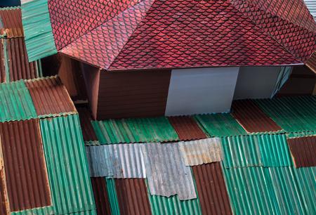 zinc: Colorful rusted zinc corrugated roof. Stock Photo