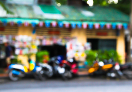 destin: Abstract blur many motobikes on the parking front yard. Stock Photo