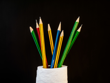 applicable: Pencil slot decoration in the tissue roll to use on back background. Stock Photo