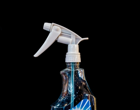cleaning spray isolated on back background. Stock Photo