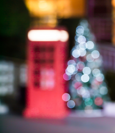 christmas tree presents: Abstract blur bokeh blurred background of decorated glowing Christmas tree and fireplace.