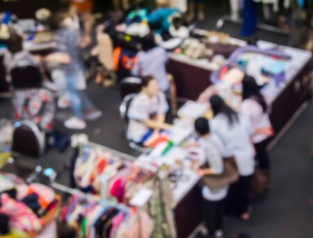 shop keeper: abstract blur the people at the  traditional clothes market. Stock Photo