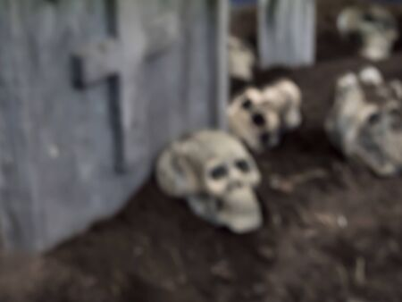 morbid: abstract blur skulls and bones in catacombs.