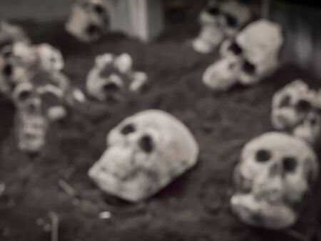 hallow: abstract blur skulls and bones in catacombs.