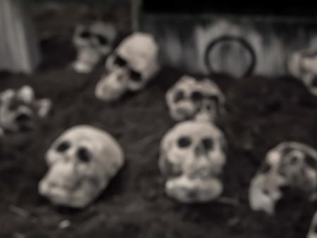 abstract blur skulls and bones in catacombs.