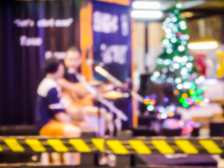 solo  christmas: abstract blur acoustic mini concert  festival in night christmas.